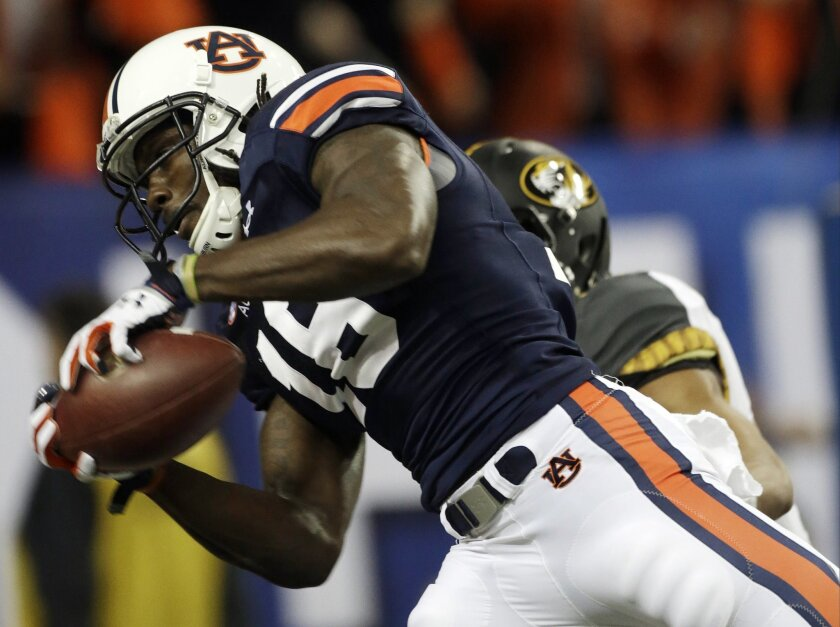 FILE - In this Dec. 7, 2013, file photo, Auburn wide receiver Sammie Coates (18) makes a touchdown catch against the Missouri during the first half of the Southeastern Conference NCAA football championship game in Atlanta. Coates has emerged as easily the Tigers' best receiver and only consistent d