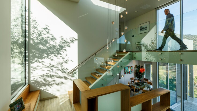 """Architect Aaron Neubert completely made over this developer's """"box."""""""