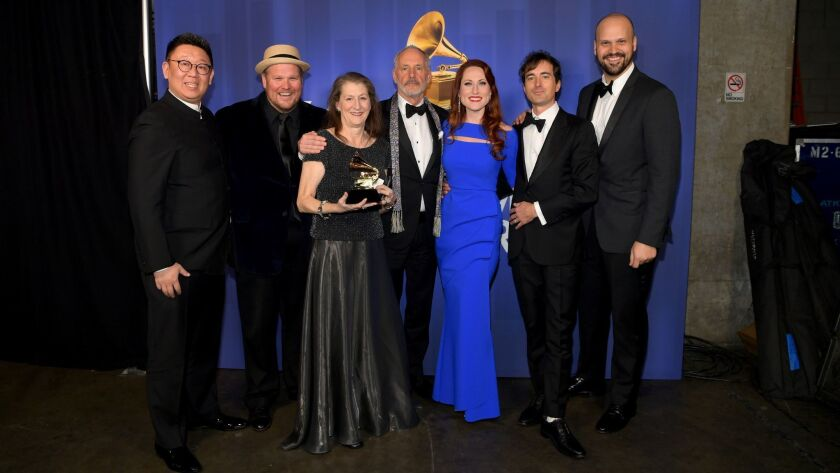 """The team behind opera recording winner """"The (R)evolution of Steve Jobs,"""" including composer Mason Bates, second from right, and Edward Parks, who played Jobs, far right, pose backstage at the Grammy Awards' pre-telecast ceremony Sunday at Microsoft Theater in L.A."""