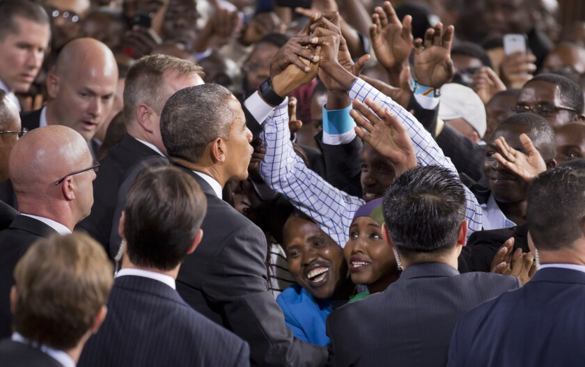 Two Kenyan women look up as President Obama reaches out to shake hands as he departs after delivering a speech at the Safaricom Indoor Arena in the Kasarani area of Nairobi, Kenya, on Sunday.