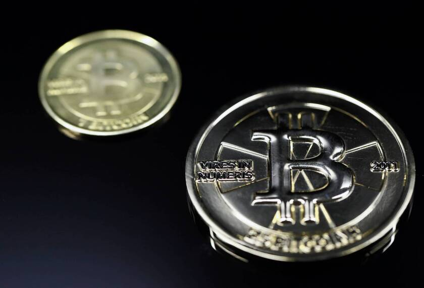 The virtual currency also has a physical form; here, a 25 Bitcoin.