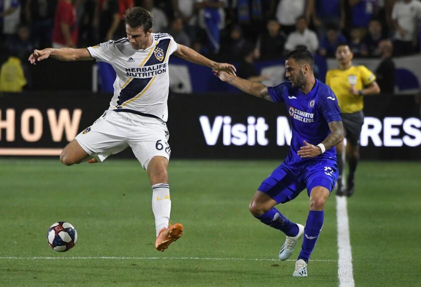 Galaxy's Nick Depuy shoots as Elias Hernandez of Cruz Azul tries to defend last summer.
