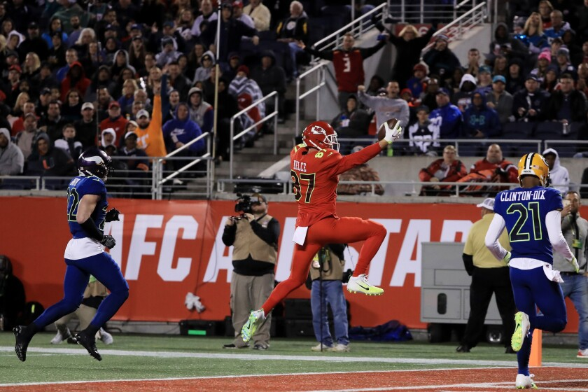 Chiefs tight end Travis Kelce (87) completes a pass for a touchdown against the NFC in the second quarter of the NFL Pro Bowl on Jan. 29.