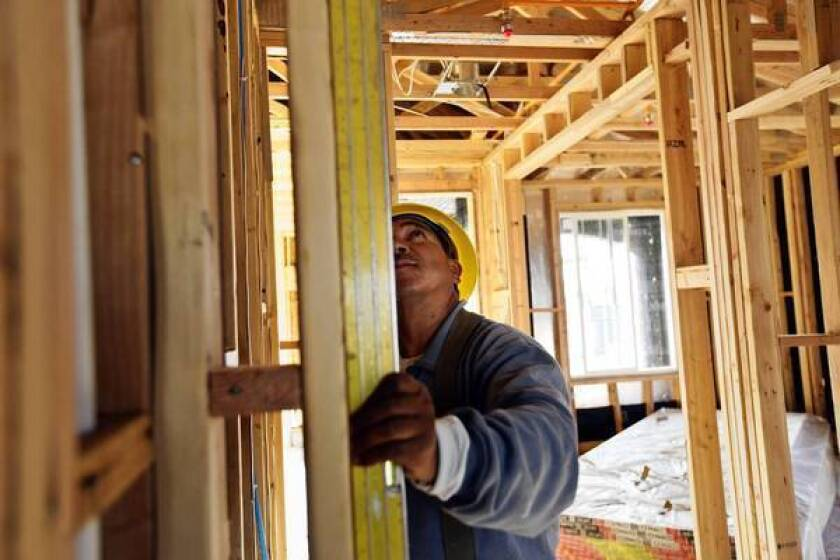 UCLA economists predict housing starts nationally will top 1 million units this year, up from 781,000 units last year. Above, a carpenter works on a new home in Beaumont, Calif.