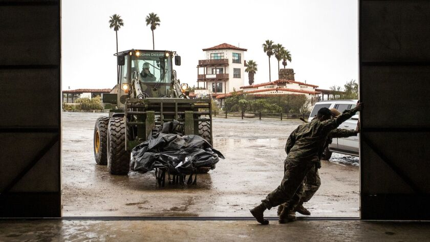 U.S. Marines move supplies into an airport hangar to begin work on the aging airport runway on Santa Catalina Island.