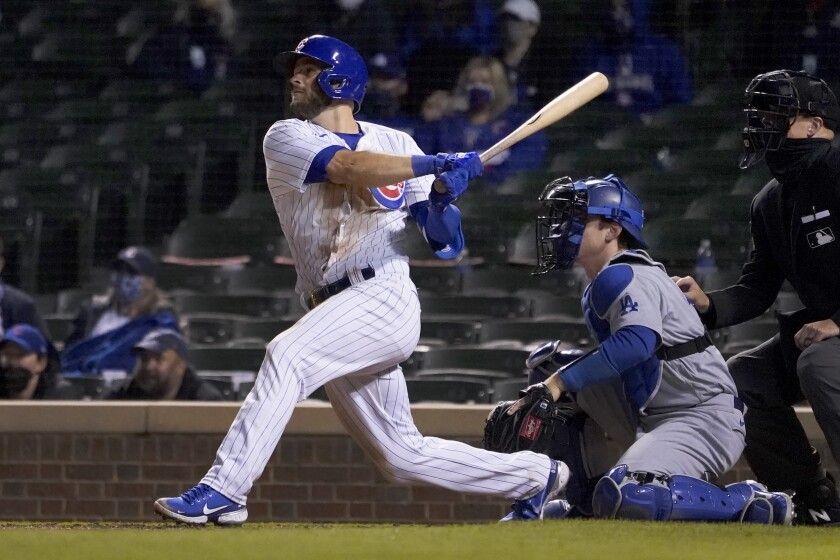 David Bote watches his game winning RBI single in the second game.