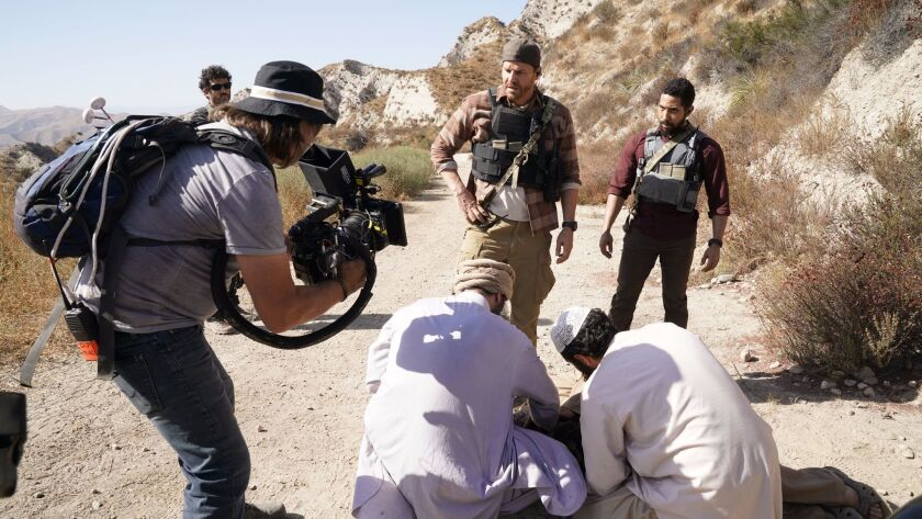 "Actors David Boreanaz, left, and Neil Brown Jr. filming a scene for the CBS series ""SEAL Team"" in northern L.A. County."