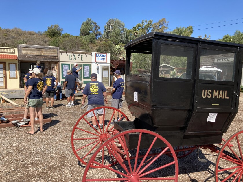 A nearly century-old postal wagon will be sheltered in a structure built by Encinitas Rotary Club members.