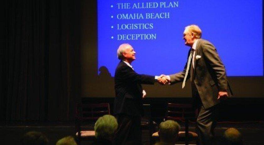 Jack Baca greets guest speaker Graham Hollands. (Photo: Jon Clark)