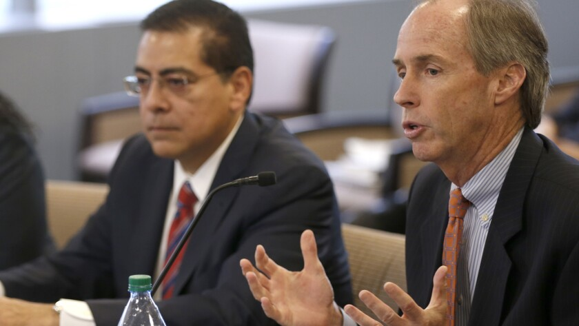 CPS chief administrator Tim Cawley, right, speaks to the Chicago Teachers' Pension Fund board at a special meeting July 1, 2015. Jesse Ruiz, interim CEO of Chicago Public Schools, is at left.