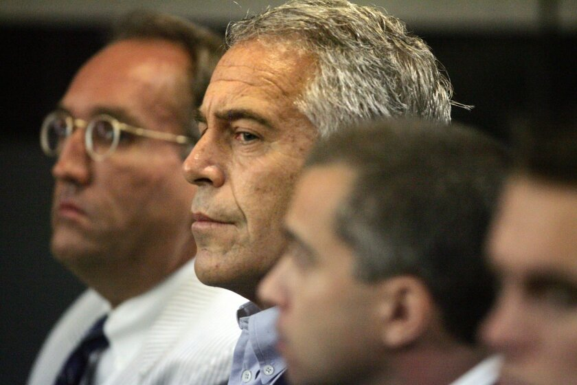 This July 30, 2008 photo shows Jeffrey Epstein in custody in West Palm Beach, Fla. Epstein was suspected nearly a decade ago of paying for sex with underage girls. The financier indicted on sex trafficking charges last month, committed suicide at a Manhattan jail, officials said on Saturday.
