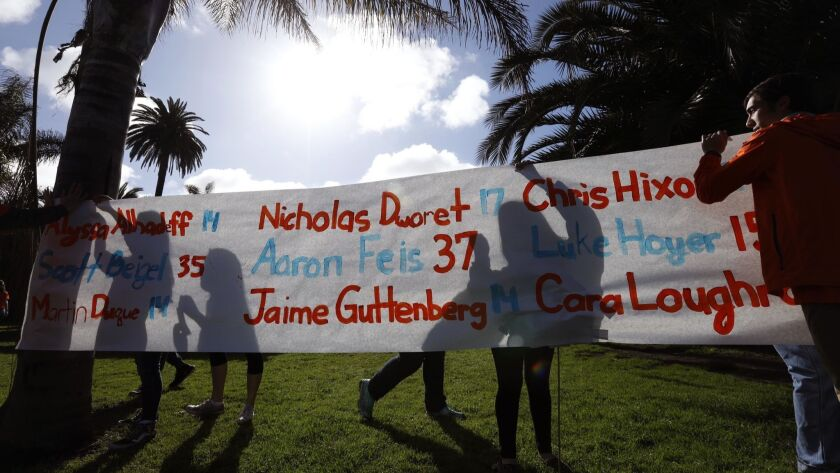 VENICE, CA - MARCH 14, 2018 - Venice High School students hang a banner with the names of the Stonem