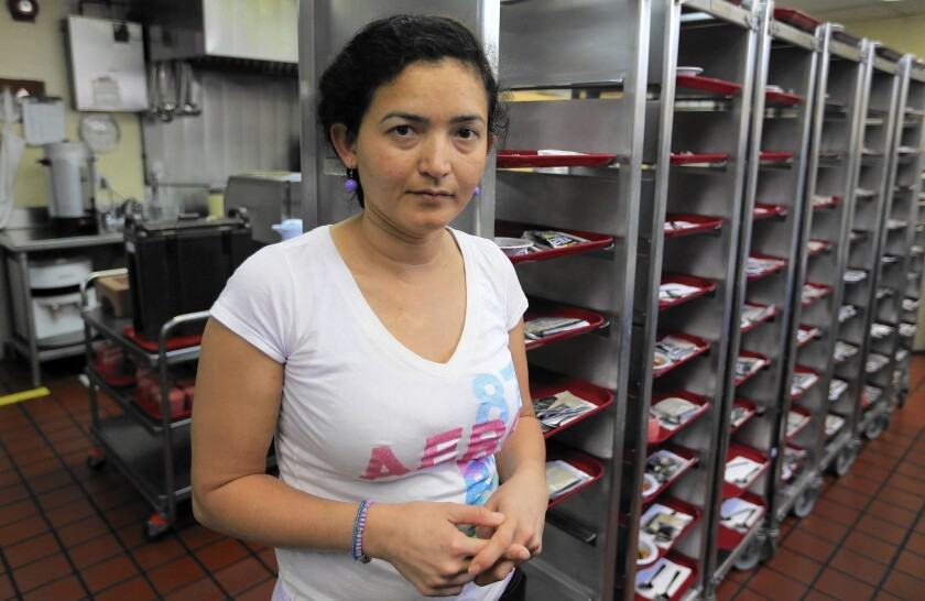 Marissa Avila, 36, a single-parent mother, earns $11.20 per hour as a dish washer at Mid-Wilshire Convalescent Hospital, but also manages an apartment complex and works occasionally at her union to help support her kids.