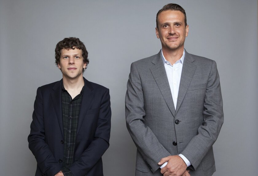 """In this Tuesday, July 14, 2015 photo, Jesse Eisenberg, left, and Jason Segel, right, pose for a portrait in promotion of their new film """"The End of the Tour"""" at the Four Seasons Hotel in Los Angeles. The movie opens in U.S. theaters on Friday, July 31, 2015. (Photo by Rebecca Cabage/Invision/AP)"""