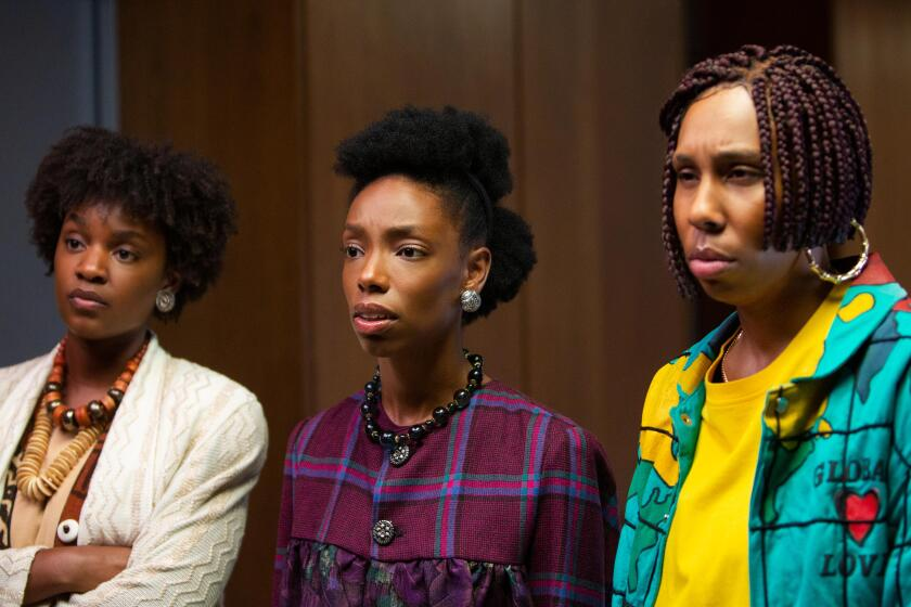 Three Black women wear 1980s period clothes and hairstyles.