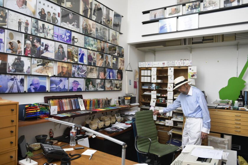 Sidney Felsen, in his Gemini G.E.L. office, with many of his photographs on the wall. The Getty Research Institute has acquired his photo archive.