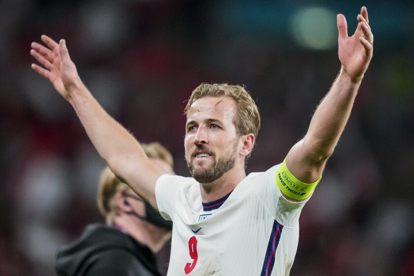 England's Harry Kane celebrates after winning the Euro 2020 soccer championship semifinal match against Denmark at Wembley stadium in London, Wednesday, July 7, 2021. (AP Photo/Frank Augstein, Pool)