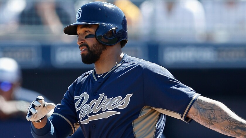 San Diego Padres outfielder Matt Kemp hits a single during an exhibition game against the Colorado Rockies on March 8.