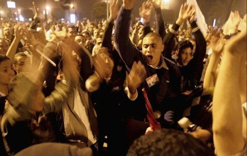 Supporters of Egypt's President Mohamed Morsi chant slogans at a rally Saturday in Cairo.