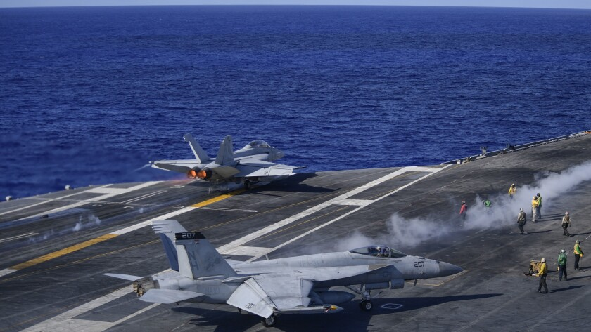 An F/A-18F Super Hornet launches from flight deck of the USS Theodore Roosevelt June 12.