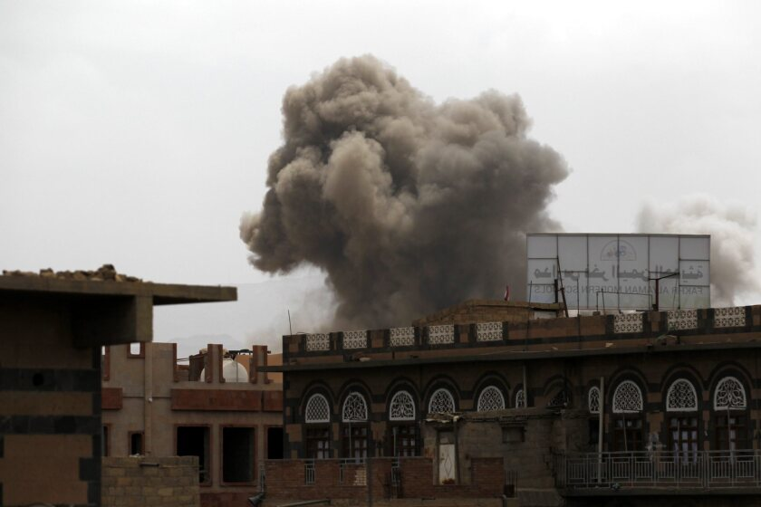 A black pall of smoke rises from a neighborhood dominated by Houthi supporters after an airstrike by the Saudi-led alliance in Sana on April 8.
