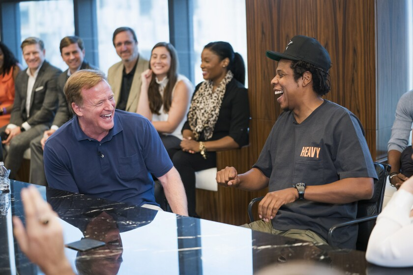 NFL Commissioner Roger Goodell, left, and Jay-Z laugh during a news conference at ROC Nation in New York on Wednesday.
