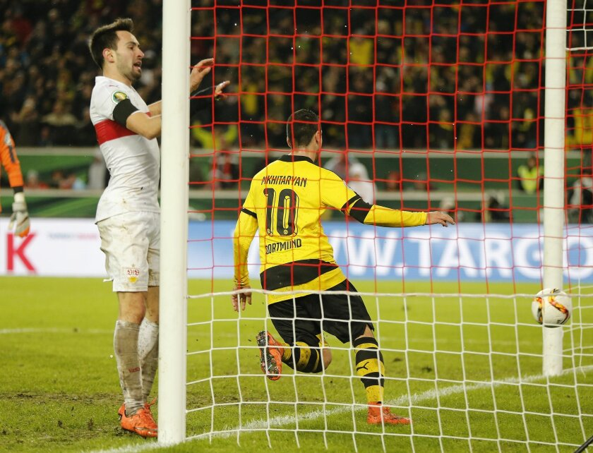 Dortmund's Henrikh Mkhitaryan scores his side's third goal during a quarterfinal match of the German soccer cup between VfB Stuttgart and Borussia Dortmund in Stuttgart, Germany, Tuesday, Feb. 9, 2016. (AP Photo/Michael Probst)