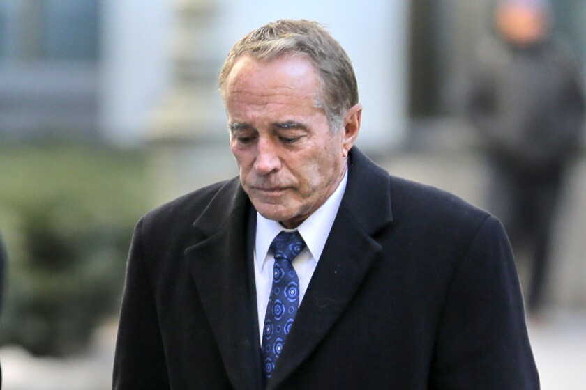 Former U.S. Rep. Chris Collins (R-N.Y.) arrives at federal court for sentencing Friday in New York. Collins pleaded guilty last fall to insider trading and lying to the FBI.