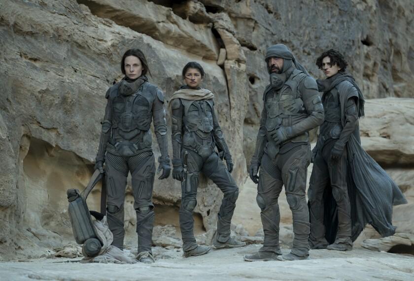 Rebecca Ferguson, Zendaya, Javier Bardem and Timothée Chalamet in a scene from  'Dune.'