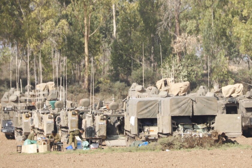 Israeli soldiers and military vehicles near the Israel-Gaza border Nov. 14.