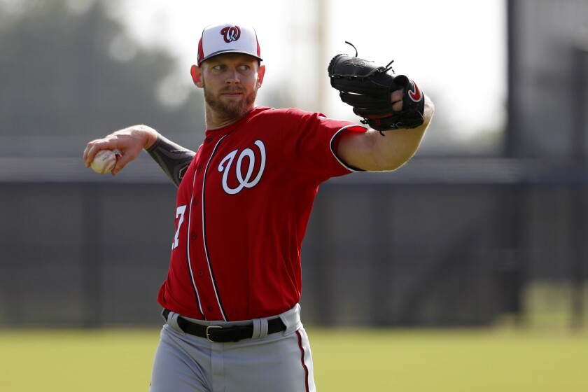 Nationals pitcher Stephen Strasburg warms up during practice on Feb. 14, 2020, in West Palm Beach, Fla.