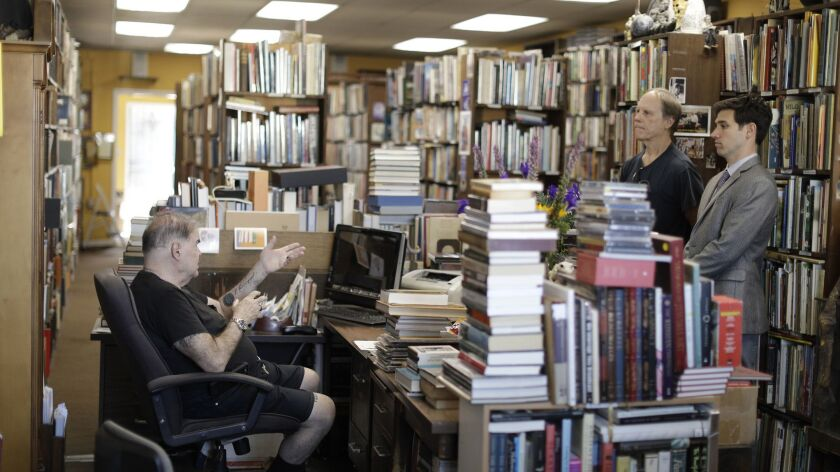 MAR VISTA, CA -- MARCH 29, 2018: David Benesty, left, manager of Sam: Johnson's Bookshop meets with
