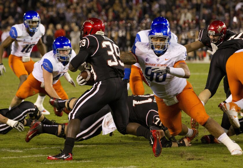 Running back Adam Muema takes off on an 81 yard touchdown run during the Aztecs football game against 10th ranked Boise State at Qualcomm Stadium Saturday night.