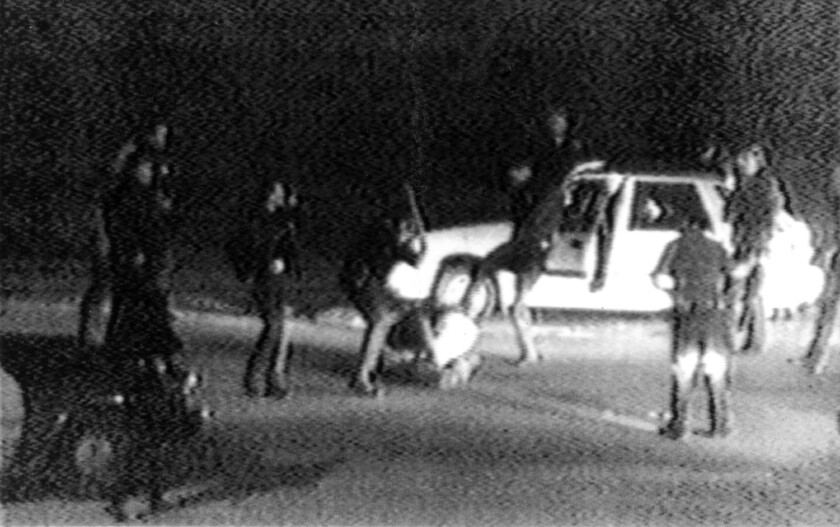 This March 31, 1991, image made from video shot by George Holliday shows police officers beating a man, later identified as Rodney King. The grainy video of him curled up on the ground became a national symbol of police brutality.
