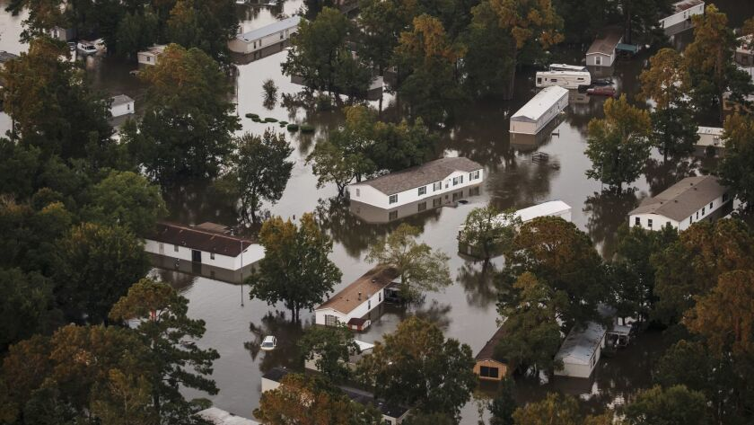 Rising floodwater surrounds homes in the wake of Tropical Storm Harvey near Lumberton, Texas.