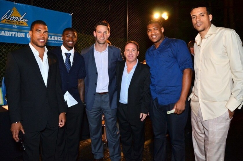 From left, Jason Bell (NFL cornerback), Bernard Berrian (NFL wide receiver), Danny Farmer (former UCLA wide receiver), Barry Saywitz (UCLA alumni and event host), David Carter (NFL defensive lineman) and Matt Barnes (NBA player) at the UCLA O.C. Dinner Celebration.