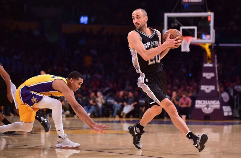 In this file photo taken on November 18, 2016 Manu Ginobili looks to pass getting away from Jordan Clarkson of the Los Angeles Lakers in Los Angeles, California during the NBA basketball matchup. - Argentina's Manu Ginobili will have his number 20 jersey retired by the NBA's San Antonio Spurs in a ceremony at a March 28 home game against Cleveland, the team announced on October 30, 2018. Ginobili won four NBA titles in 16 NBA seasons with the Spurs with a career .721 win percentage, his 762-295 record the best in NBA history among players with at least 1,000 league appearances.