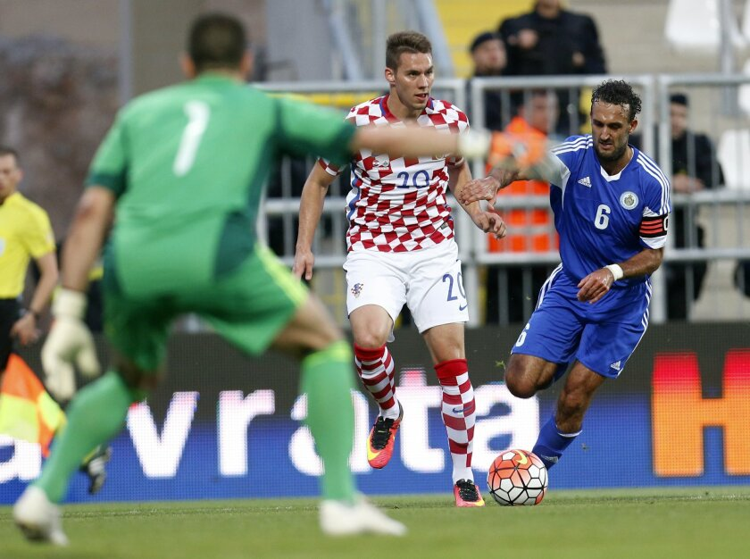 Croatia's Marko Pjaca, center, is challenged by San Marino's Alessandro Della Valle, right, during the international friendly soccer match between Croatia and San Marino, in Rijeka, Croatia, Saturday, June 4, 2016. (AP Photo/Darko Bandic)