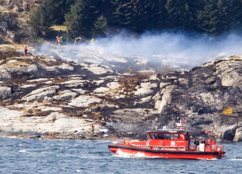 Rescue personnel search near the site of a helicopter crash west of the Norwegian city of Bergen on April 29.