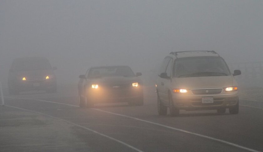 The fog was thick on N. Torrey Pines Road in La Jolla on Monday morning.