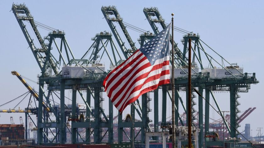 "The U.S. flag flies at the Port of Long Beach. President Trump's promised ""economic boom"" is unlikely to happen without major legislation, according to a White House report."