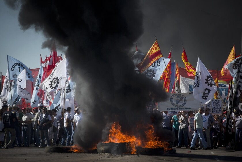 Workers block a bridge with burning tires during a general strike in Buenos Aires.