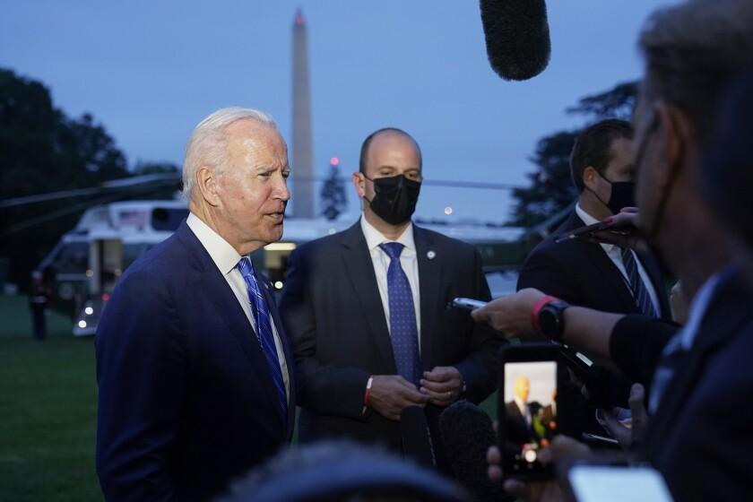 President Joe Biden talks with reporters.