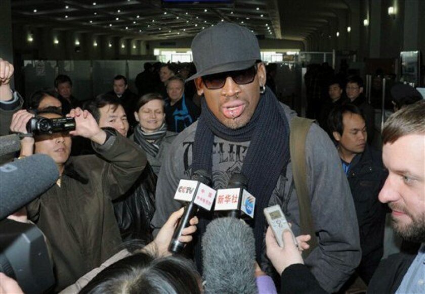 """Former NBA star Dennis Rodman speaks to the media at the Pyongyang Airport in Pyongyang, before he leaves North Korea Friday, March 1, 2013.  Ending his unexpected round of basketball diplomacy in North Korea on Friday, Rodman called leader Kim Jong Un an """"awesome guy"""" and said his father and grand"""