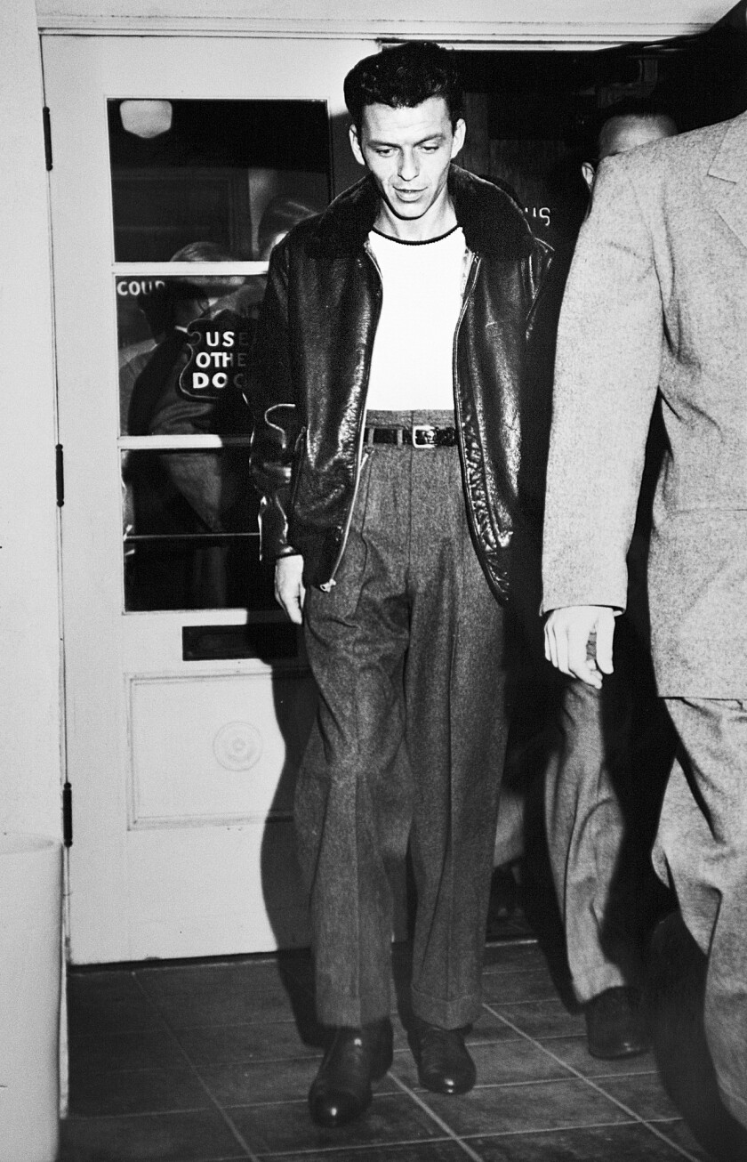 A rare Los Angeles Times photo of Frank Sinatra in 1947, leaving a Beverly Hills courthouse after charges against him for allegedly slugging columnist Lee Mortimer were dismissed.