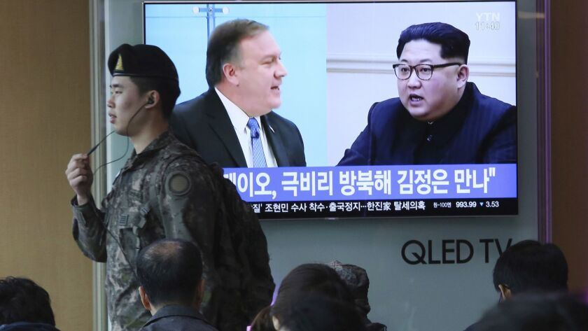 Images of CIA Director Mike Pompeo, left, and North Korean leader Kim Jong Un on a South Korean news program on a video screen at the Seoul train station on April 18, 2018.