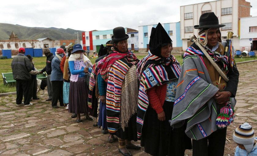 Aymara Indians line up to vote at a voting center during the constitution referendum in Jesus de Machaca, Bolivia, Sunday, Feb. 21, 2016. Bolivians are voting in a referendum on whether to amend the constitution so that President Evo Morales can run in 2019 for a fourth consecutive term.(AP Photo/J