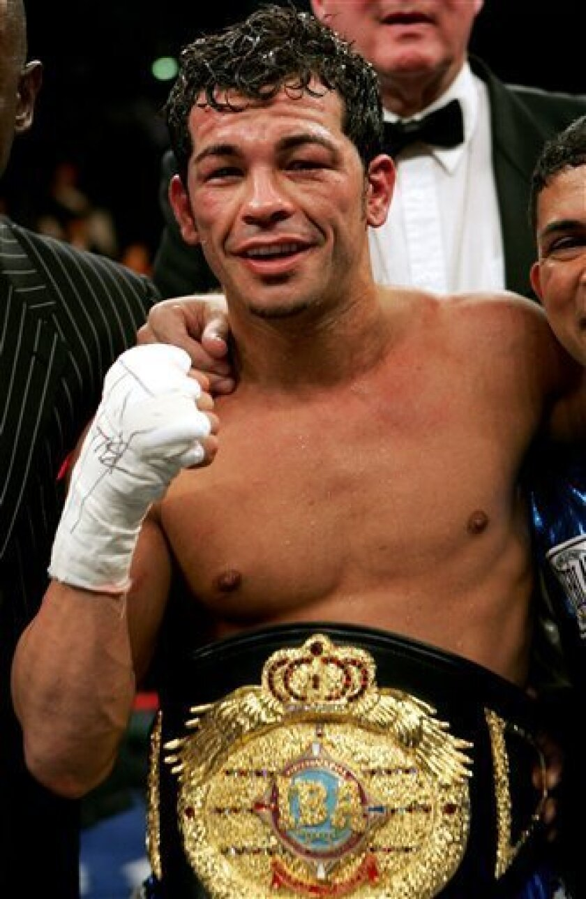 FILE - In this Jan. 28, 2006 file photo, Arturo Gatti of Jersey City, N.J., celebrates his win over Thomas Damgaard of Denmark in their IBA Welterweight Championship fight at Atlantic City Boardwalk Hall in Atlantic City, N.J. Officials say Gatti has been found dead in a hotel room at the seaside resort of Porto de Galinhas in northeastern Brazil on Saturday, July 11, 2009, where he arrived on Friday with his wife and one-year-old son. The spokesman said it was unclear how Gatti died. He was 37. (AP Photo/Mel Evans, File)