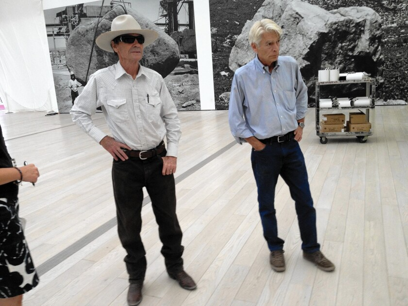 John Bowsher, right, vice president of museum infrastructure at LACMA. At left is Michael Heizer, the artist who created the Levitated Mass work of art.