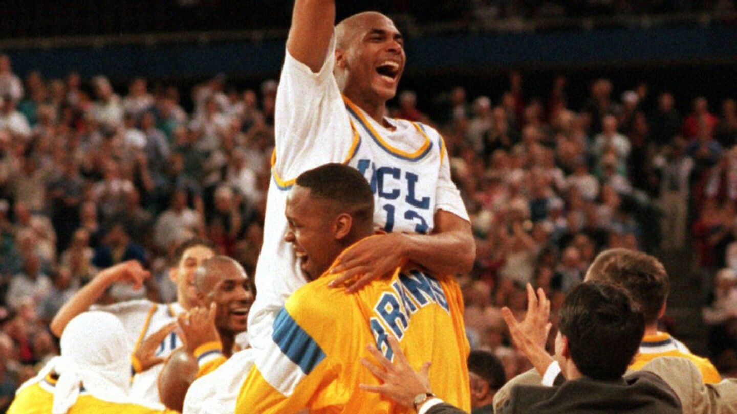 Ed O'Bannon is lifted into the air by teammate Ike Nwankwo after the Bruins defeated Arkansas in the NCAA championship game in Seattle.